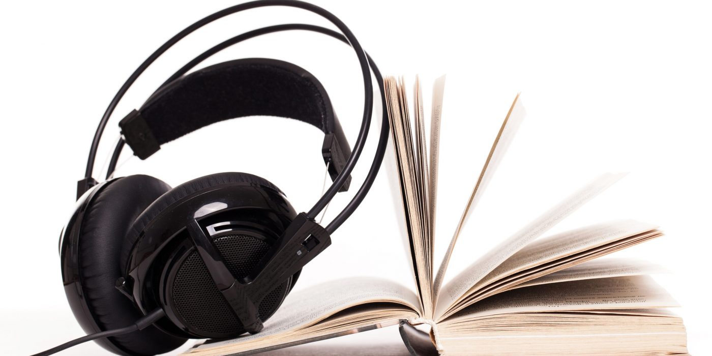 Big headphones and book on a white background